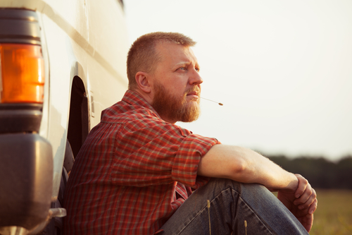 Red-bearded man in jeans on a summer evening