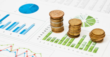 Graphs and charts with stacks of coins