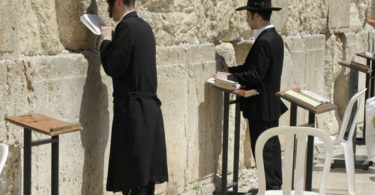 jewish men praying at the wailing wall, jerusalem, israel