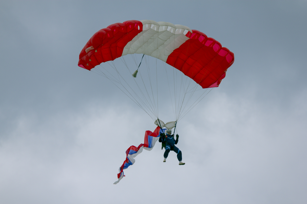 Russian parachutist is flying in the skies