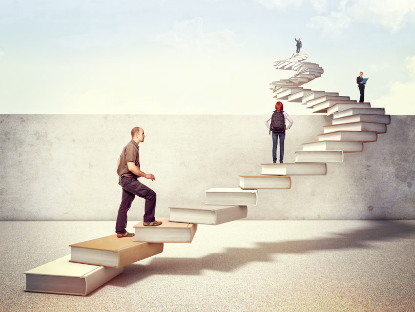 people on 3d books stair cross the wall