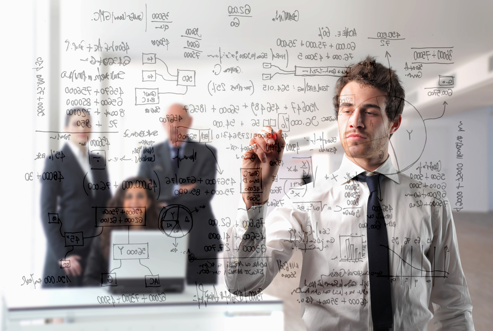 Businessman writing some schemes with group of business people on the background