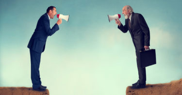 businessmen shouting through megaphones business conflict concept