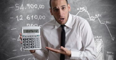 Businessman show negative number of tax and crisis