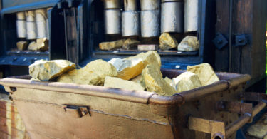 Trolley with gold ore in the gold mine in museum