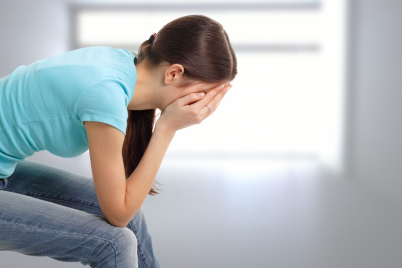 depression teen girl cried lonely in room