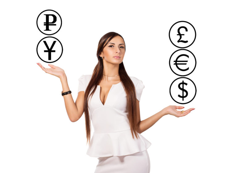 Modern young business woman standing and currency manipulation. Businesswoman juggling. Active business lady dressed in white. White background. Businesswoman holding hands on the similarity scales.