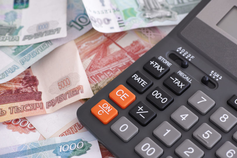 Russian ruble banknotes and calculator. Close up.