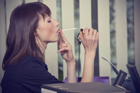 business-woman-smoking-at-the-office-561289