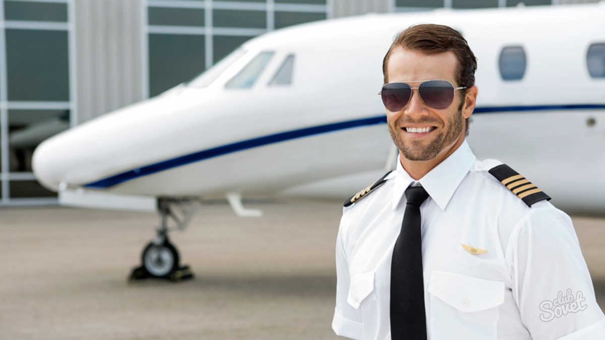 Confident pilot smiling in front of private jet; Shutterstock ID 171215267; PO: today.com